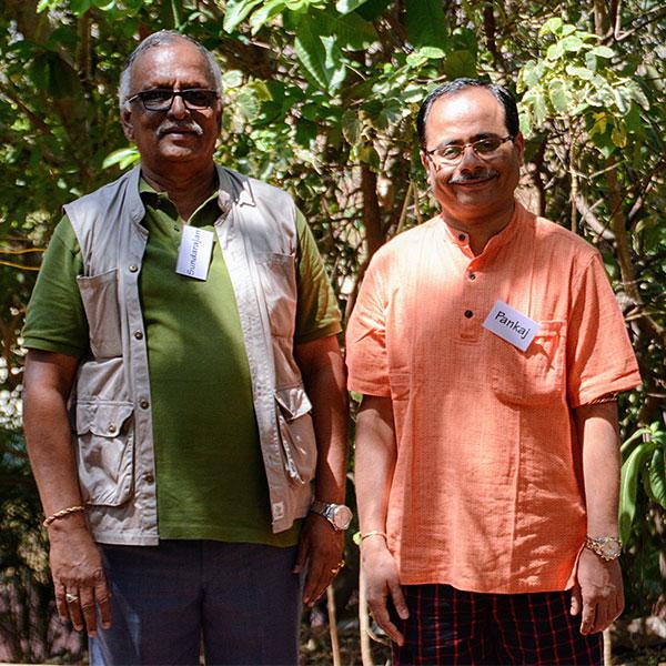 Ananda Pune two men devotees
